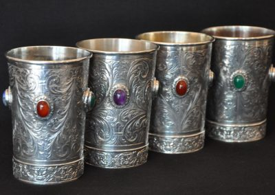 A set of four silver beakers inset with stones. Coppini Silversmith Florence.