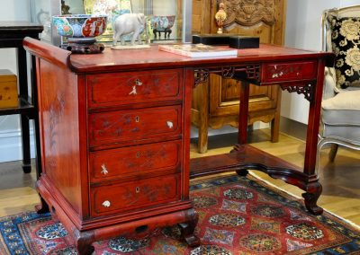 A French red lacquered desk with tooled leather top circa 1920.