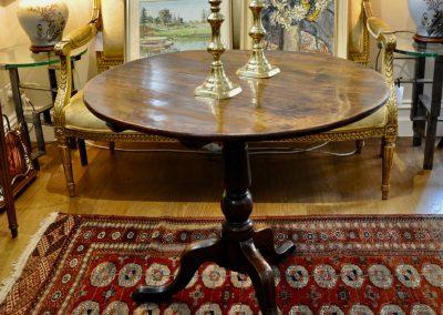 An 18th century tripod table.
