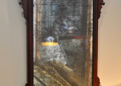 An 18th century fret mirror with original plate c.1760.
