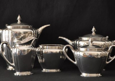 A five piece American silver teaset. Orchid pattern c.1920.