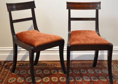 A pair of Regency mahogany chairs.
