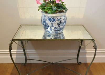 A French iron table with original mirror top c.1920.