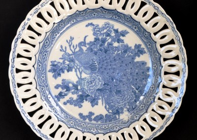 A Japanese blue & white plate with pierced border.