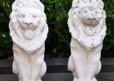 A pair of composite stone lions.