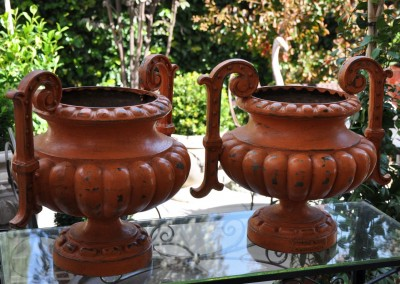 A pair of 19th century French cast iron urns.