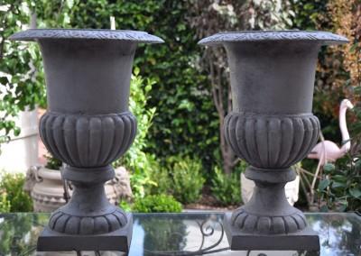 A pair of cast iron garden urns c.1880.