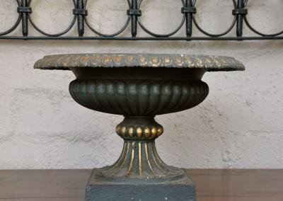 A cast iron garden urn.