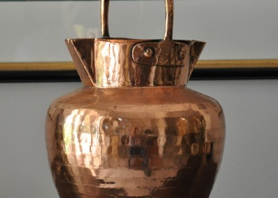 A 19th century copper and brass water pourer.
