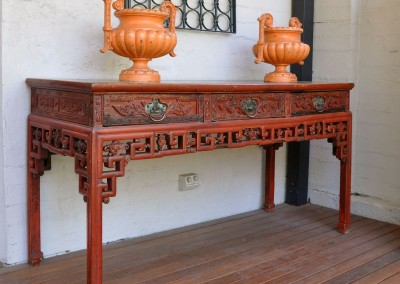 A Chinese red lacquered table c.1880.