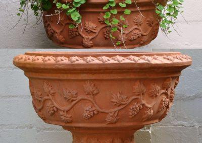 A pair of Italian terracotta urns.