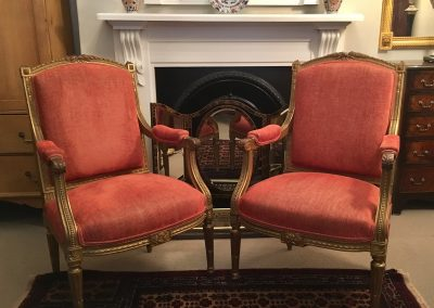 A pair of 19th century French chairs with giltwood frames.