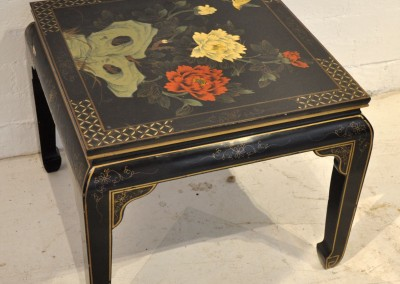 A 1930s lacquered coffee table.