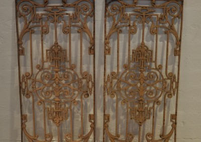 A pair of cast iron panels.