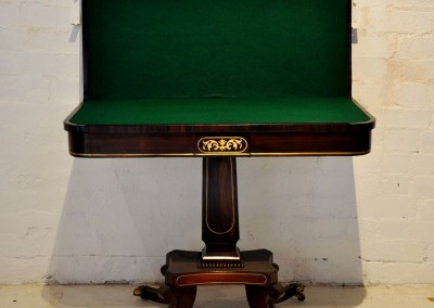 A Regency rosewood card table with brass inlay.