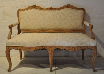 A 19th Century French Settee with carved frame.